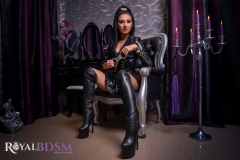 Fetish-Julia-in-leather-with-boots-and-handcuffs-LOGO