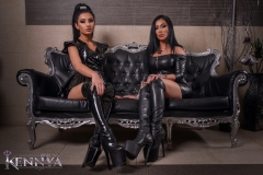 Mistress-Kennya-and-Fetish-Victoria-in-leather-and-boots-sitting-2-marked