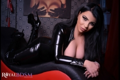 Mistress-Elenia-in-latex-on-couch-looking