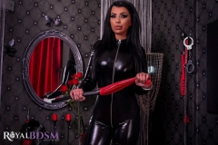 Mistress-Elenia-standing-in-latex-with-red-whip