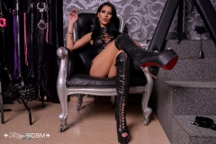 Mistress-Lexa-with-boots-on-chair