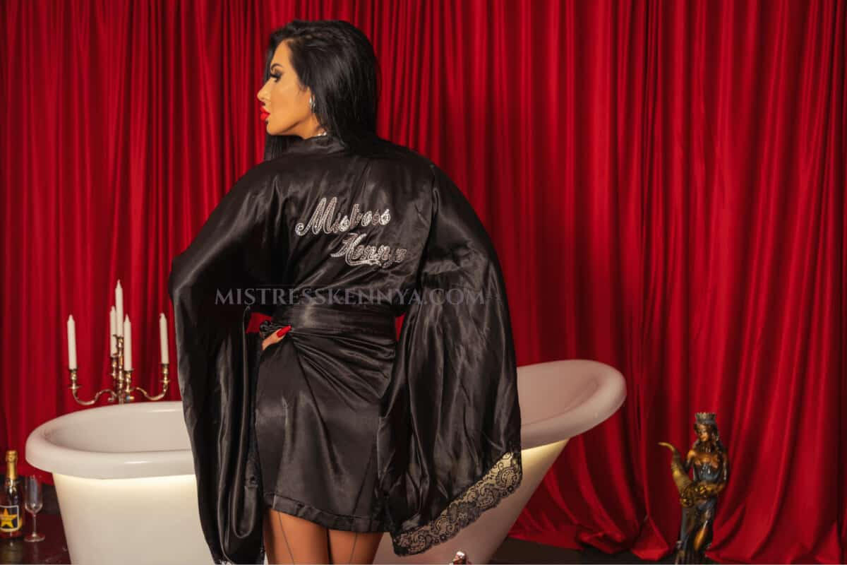 Mistress Kennya in bathrobe in front of the bath